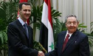 Bashar al-Assad y Raul Castro.