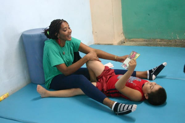 Physical therapist with a child.